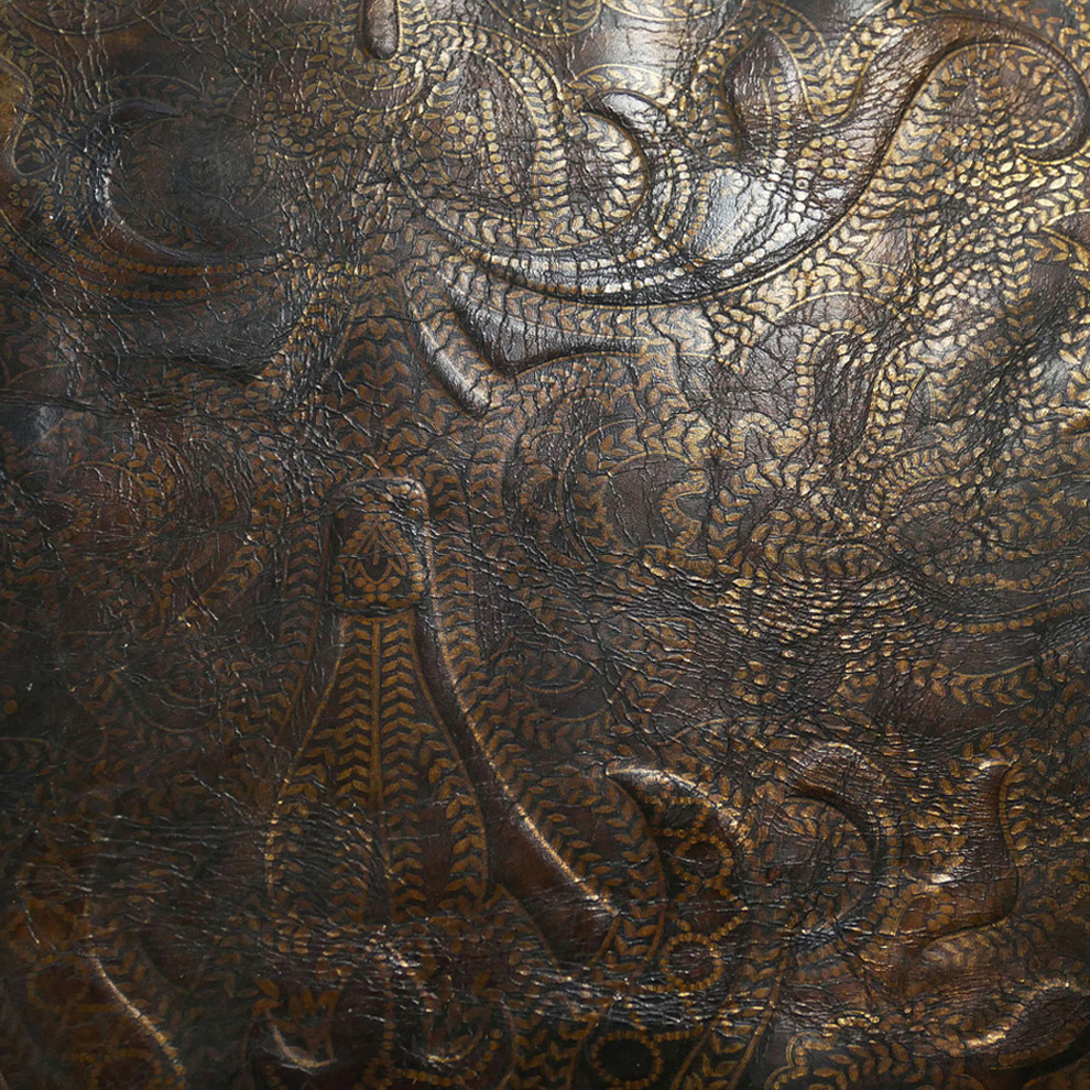 Aged embossed bronze leather